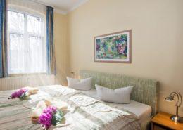 Ferienwohnung Opal Schlafzimmer 2 - Urlaubshotel Strandvilla Imperator mit Ferienwohnungen und Zimmern im Seebad Bansin auf Usedom