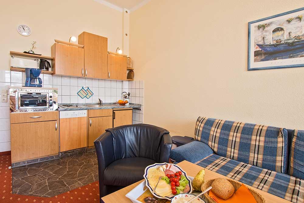Ferienwohnung Onyx Doppelbett Küchenzeile