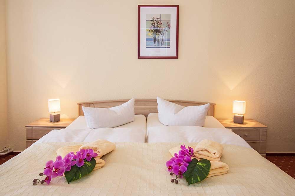 Ferienwohnung Onyx Doppelbett Schlafbereich